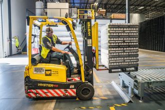 worker moving a forklift truck