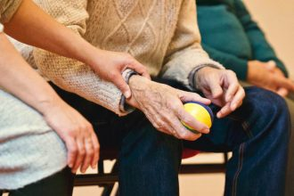 elderly woman holding a ball