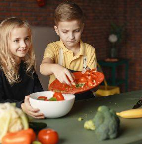 children preparing a healthy salad