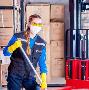 woman in mask working in warehouse
