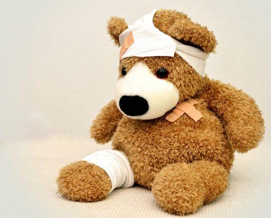 a bandaged teddy bear
