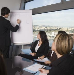 man giving presentation to colleagues