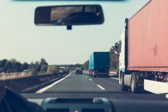 cars and trucks on the motorway