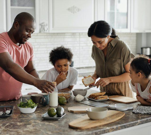 family making breakfast in kitchen