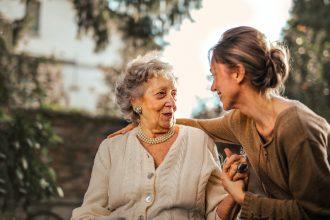 elderly woman speaking to daughter