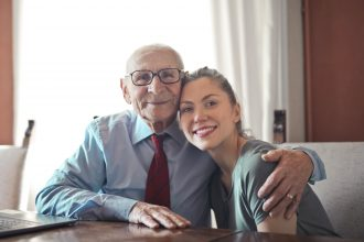 elderly man hugging daughter