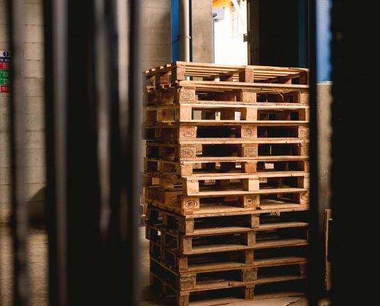 a stack of thin wooden crates