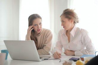 businesswomen discussing problems