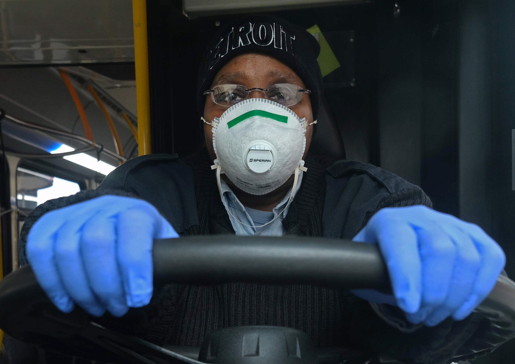 a woman driving a bus