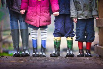 children in wellington boots