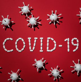 concept of covid 19 in red