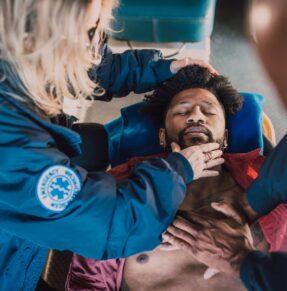 Paramedics performing CPR
